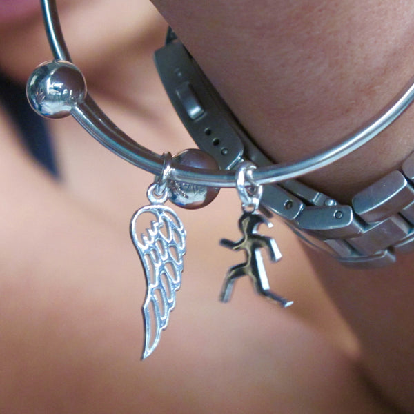 Timeless Magic: Angel Wing Charm