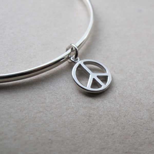 Timeless Magic: Peace Charm