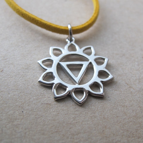 Manipura Chakra sterling silver pendant on a yellow faux leather thread.