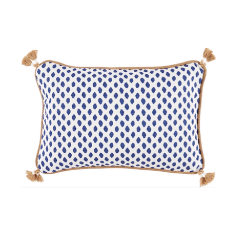 "White lumbar pillow with navy spots and jute trim with tassels; 13""x19"""