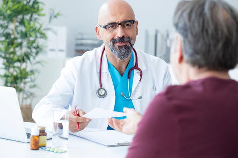 male doctor speaking to patient