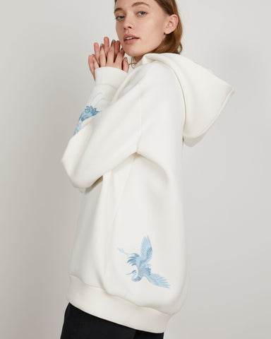 White Hoodie with blue bird has a cozy oversized fit in spongey rayon.