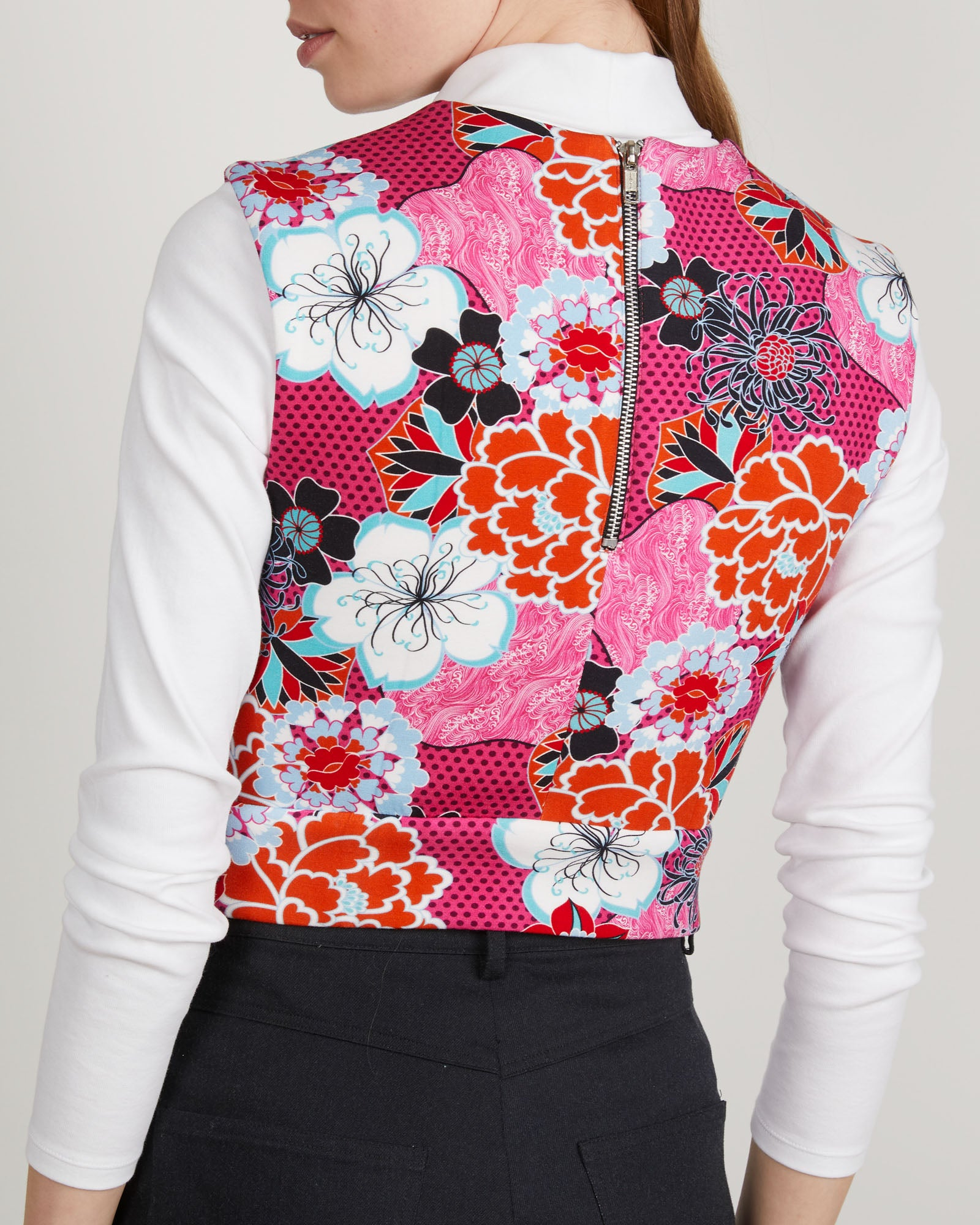 THE KIT's Leah Vest in Pink Pop Floral print is a seasonless layering piece that hits at the natural waist with a fitted silhouette. Centerback zipper hardware adds interest to this styling piece in a spongey heavy rayon.
