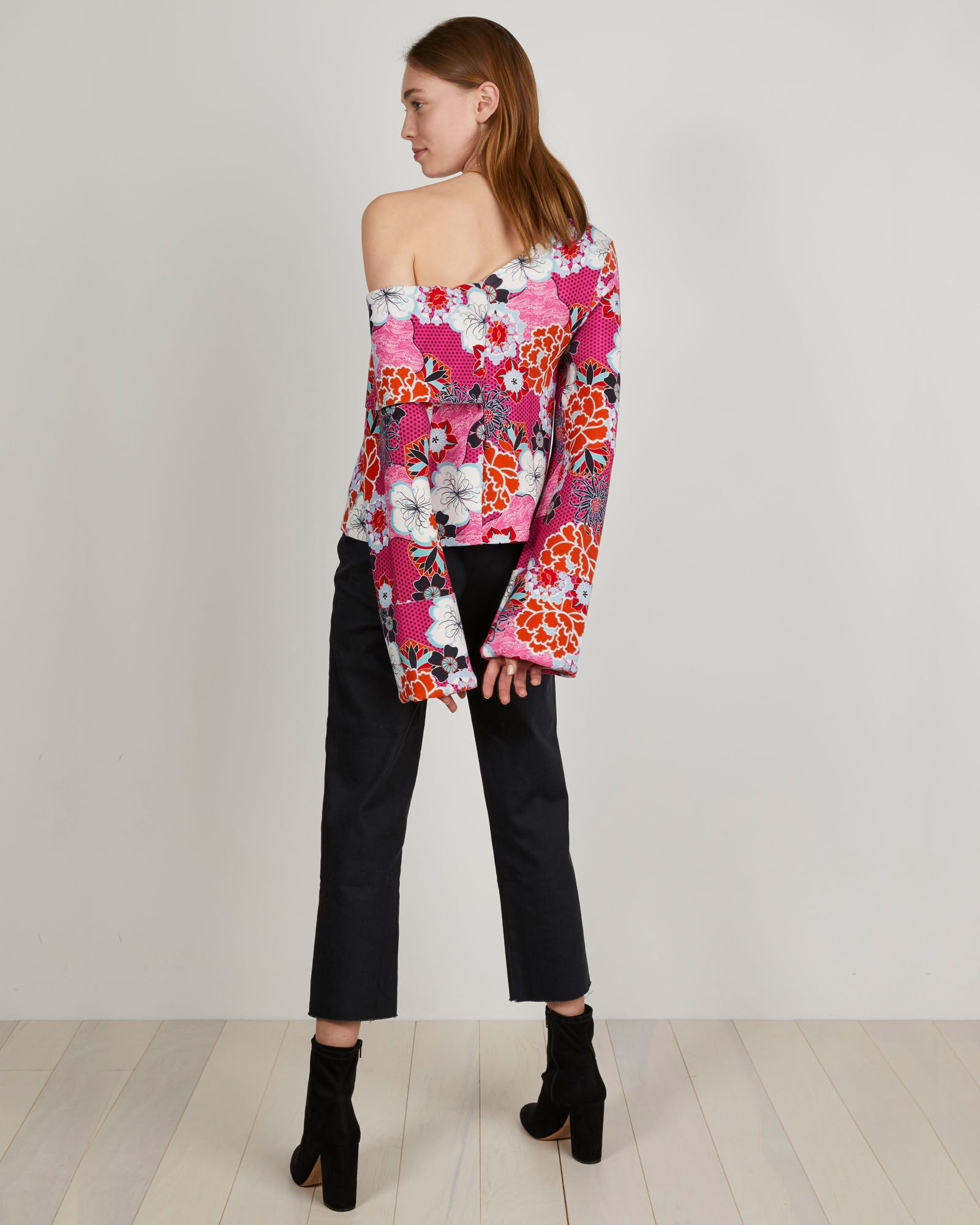 THE KIT's Logan Sweatshirt in a hot pink pop floral print has a relaxed off-the-shoulder fit and exaggerated sleeve cuffs