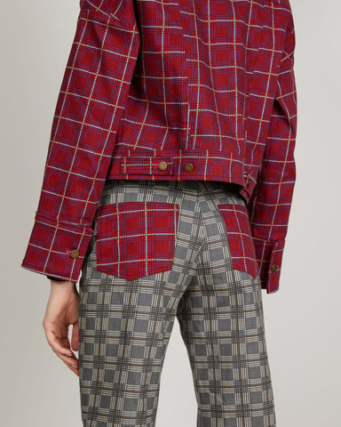 Alexa Jean is a straight-leg, high-waisted pant with plaid pockets. This jean also has a raw edge hem and cropped length.