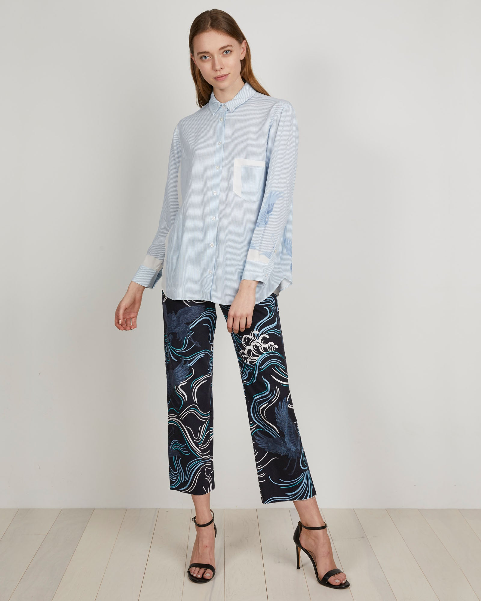 THE KIT's Zoe Shirt in striped sky blue bird is a relaxed button-front viscose shirt with a single chest pocket and oversized feel