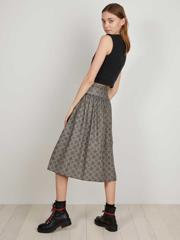 THE KIT's Dorothy Skirt in tan glen plaid is an off-center, button-front full skirt with a fitted waist, asymmetrical gathering and dropped hem. In brushed cotton flannel.