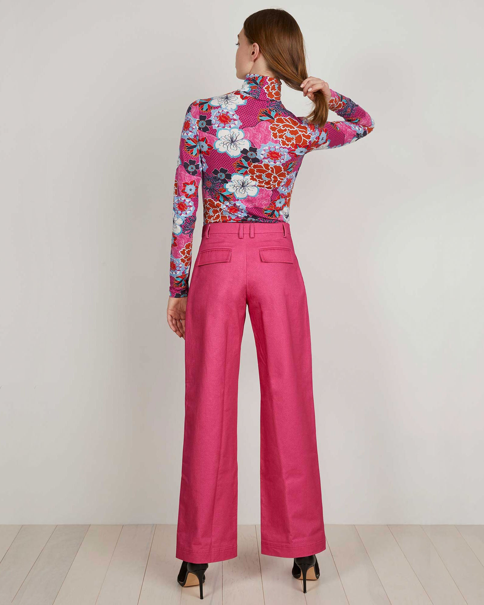 THE KIT's hot pink Turtleneck has a slim, stretchy fit great for layering and a bold pink pop floral print. Cut from a super soft bamboo cotton it's a super soft alternative.