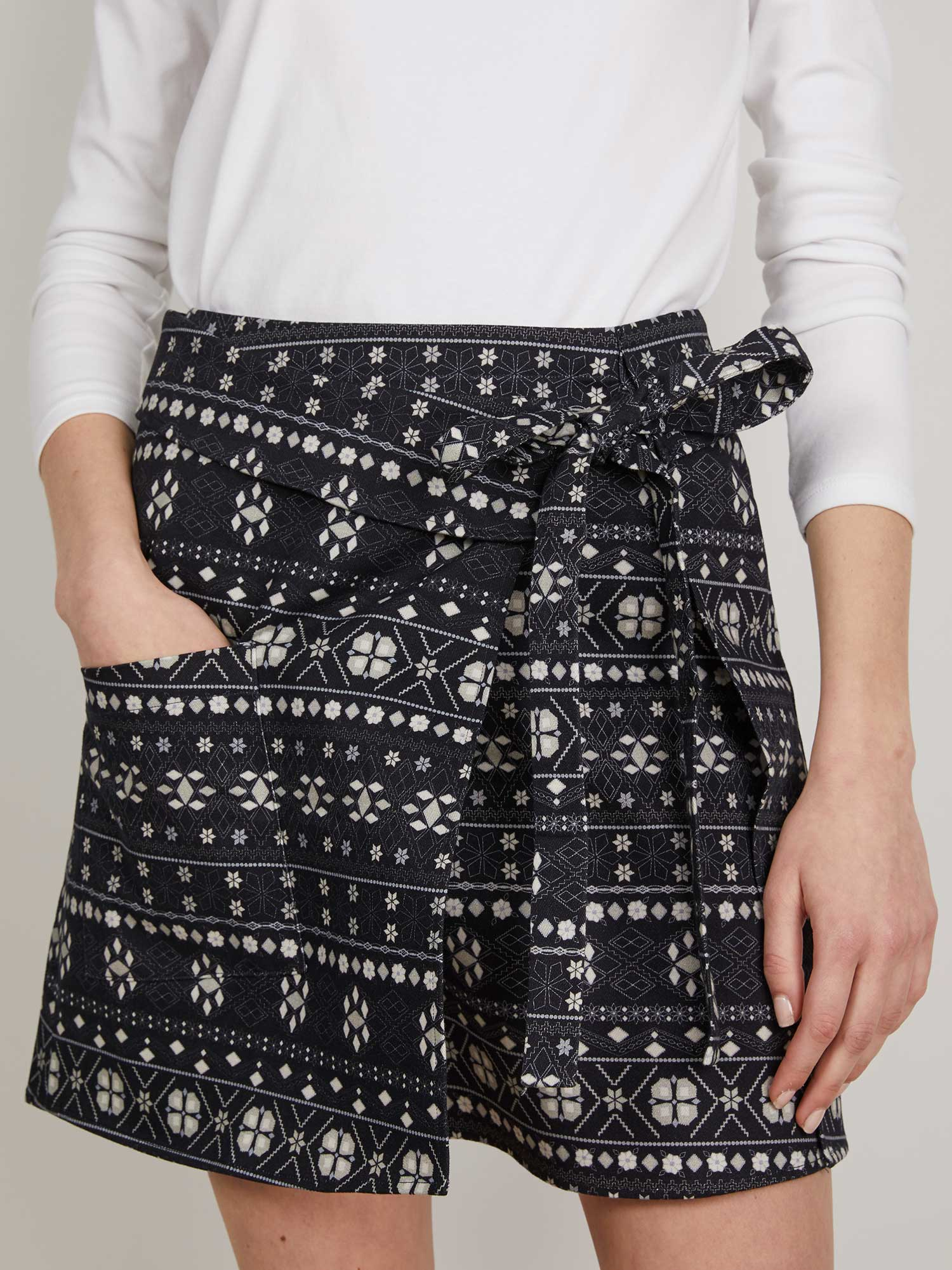 The KIT Wrap Kilt Skirt Navy Fair Isle Brushed Cotton Bold Prints Skirt THE KIT's Wrap Kilt Skirt is a mid-thigh heavy-brushed cotton skirt has a side-front waist tie and cargo pocket Batik Print Navy Blue