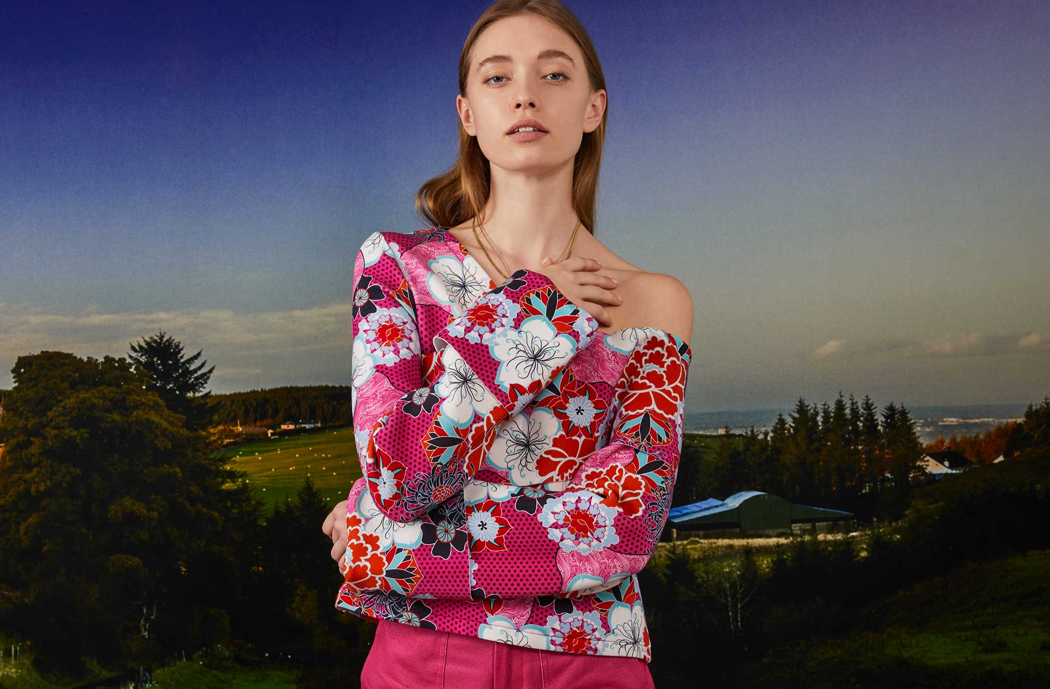 THE KIT's Logan Sweatshirt in a hot pink pop floral print has a relaxed off-the-shoulder fit and exaggerated sleeve cuffs.