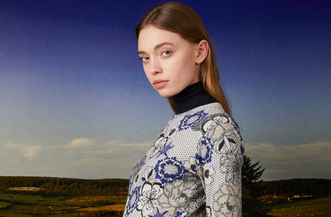 the kit woman against lanscape floral print dress turtleneck