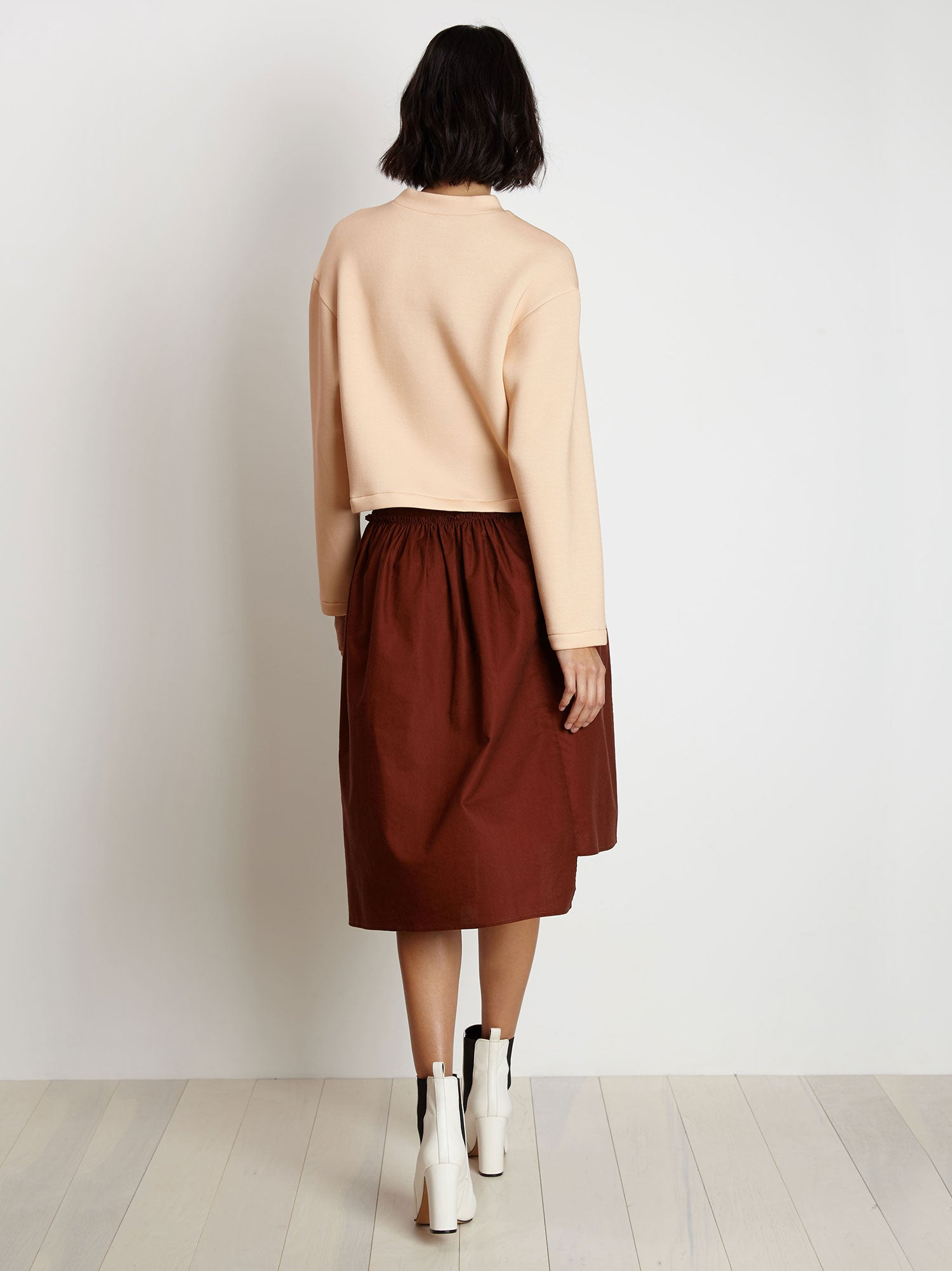 Sweatshirt in Peach is a light-weight crewneck sweatshirt with a boxy fit