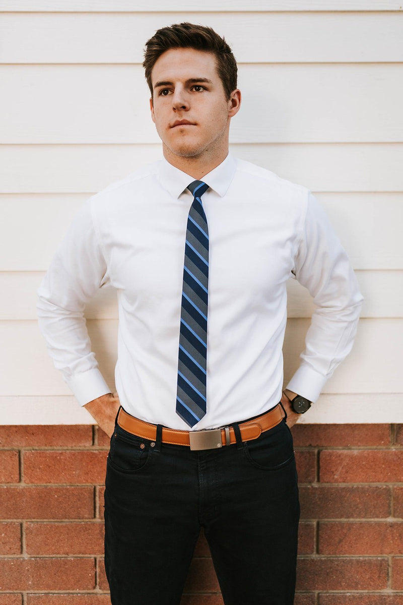 man in camel belt and grey and navy striped tie