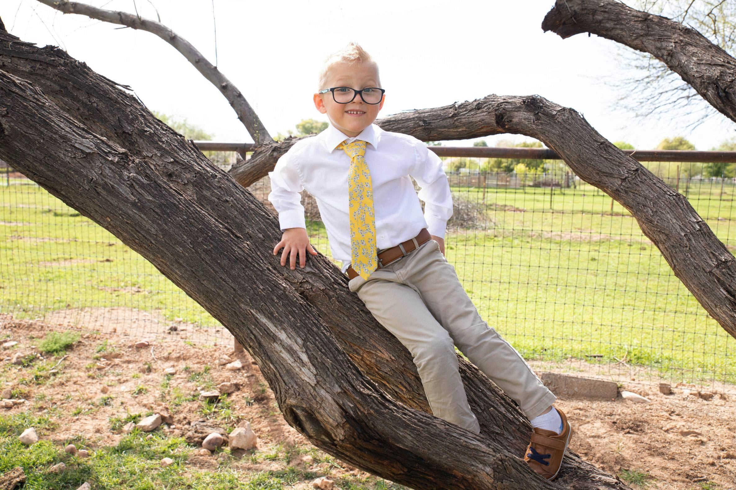 little boy wearing yellow floral tie