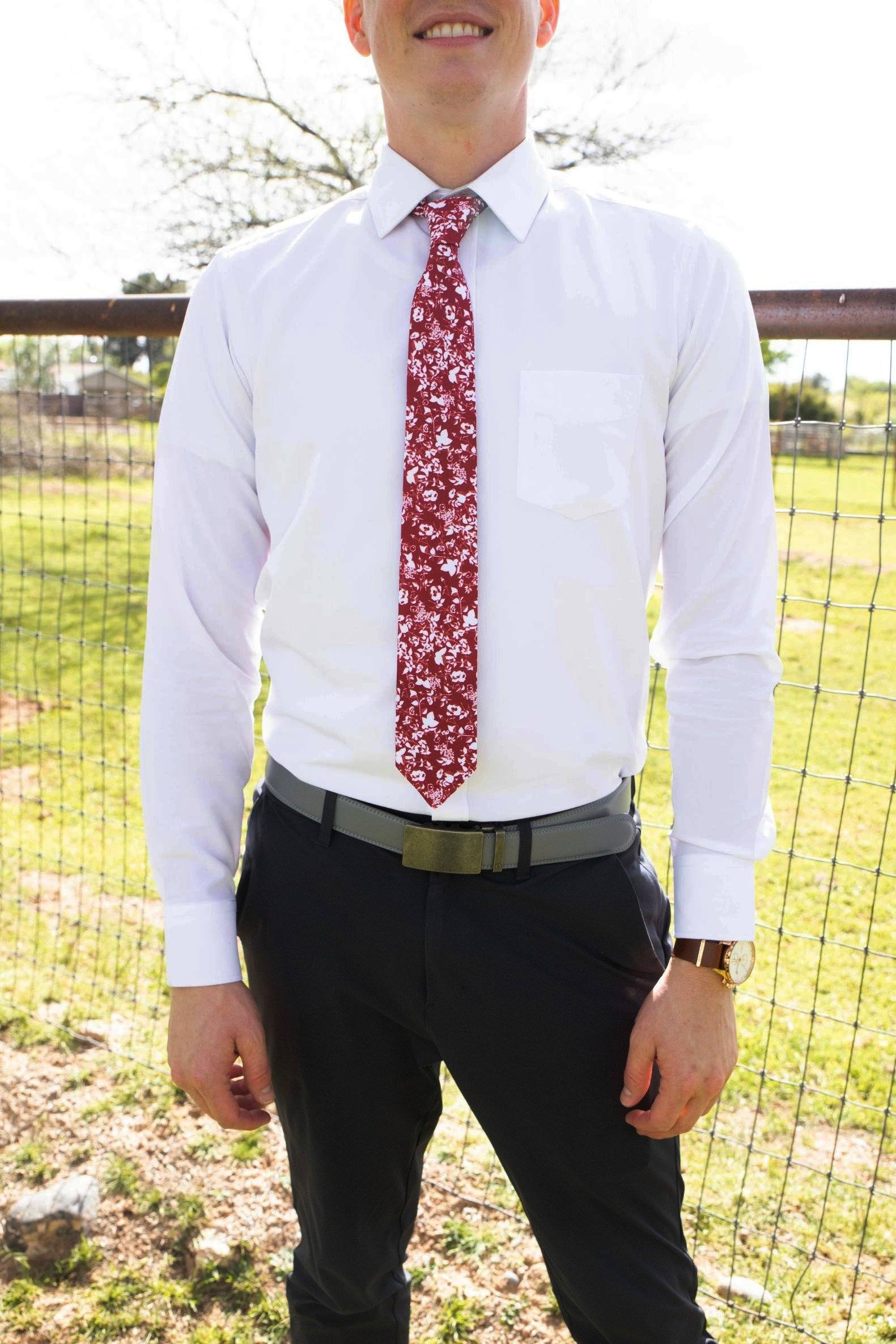 man wearing white shirt and crimson red floral tie