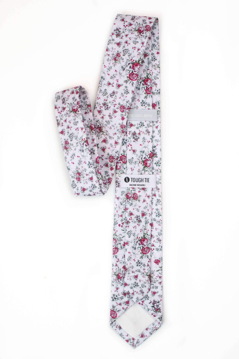 back view of white floral tie with red roses