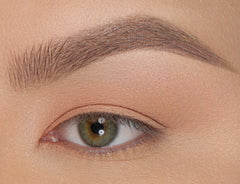 Apply Boutineer in brow bone and Powder Room on crease.
