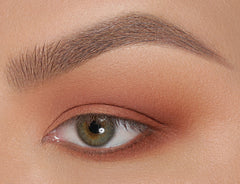 Apply Vintage Feels on crease, lower lash line and smoke out.