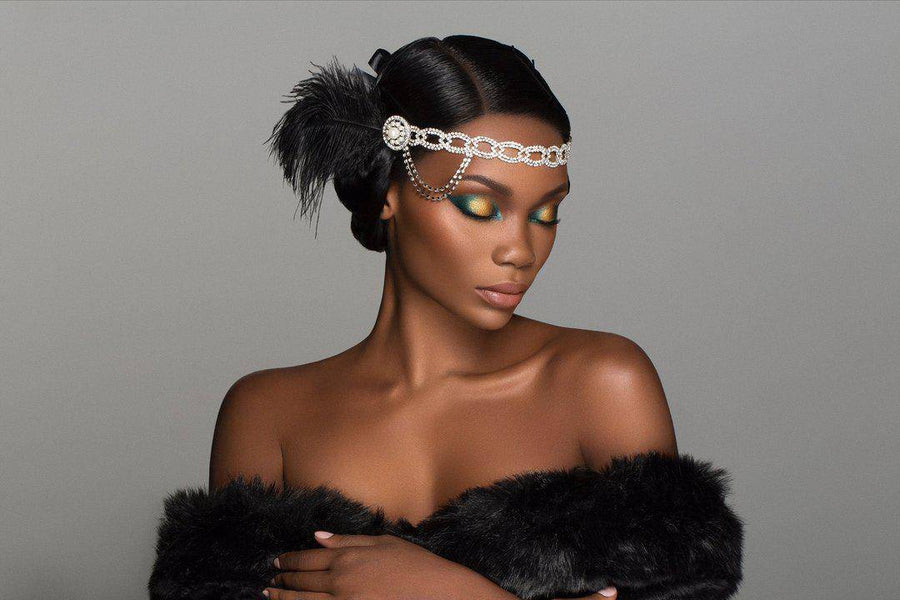 Cheers To The Beauty™ eyeshadow and highlighter palette worn on a dark-skinned model in flapper style
