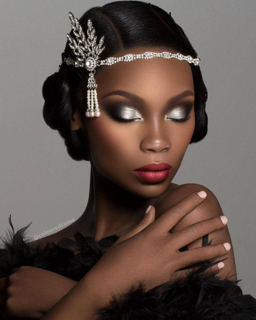Cheers To The Beauty™ eyeshadow and highlighter palette worn on a dark-skinned model with head dress