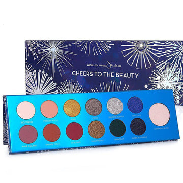 Cheers To The Beauty™ eyeshadow and highlighter palette by Coloured Raine Cosmetics
