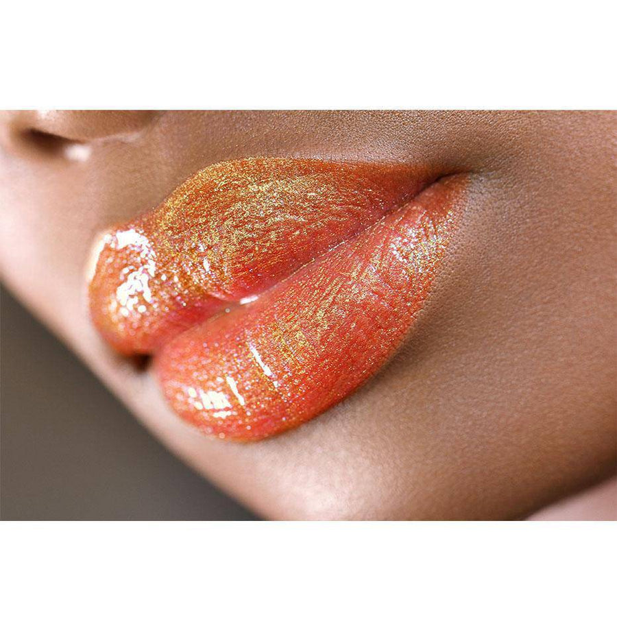 This non-sticky peach lip gloss delivers intense color - Firecracker by Coloured Raine Cosmetics