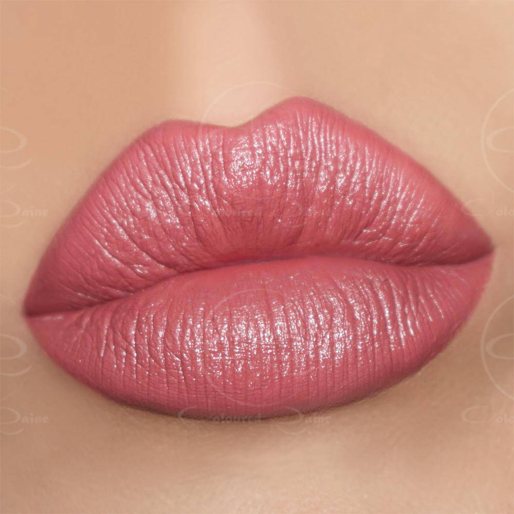 Foxy Lady by Coloured Raine Cosmetics is a red lipstick that is rightfully flirtatious.