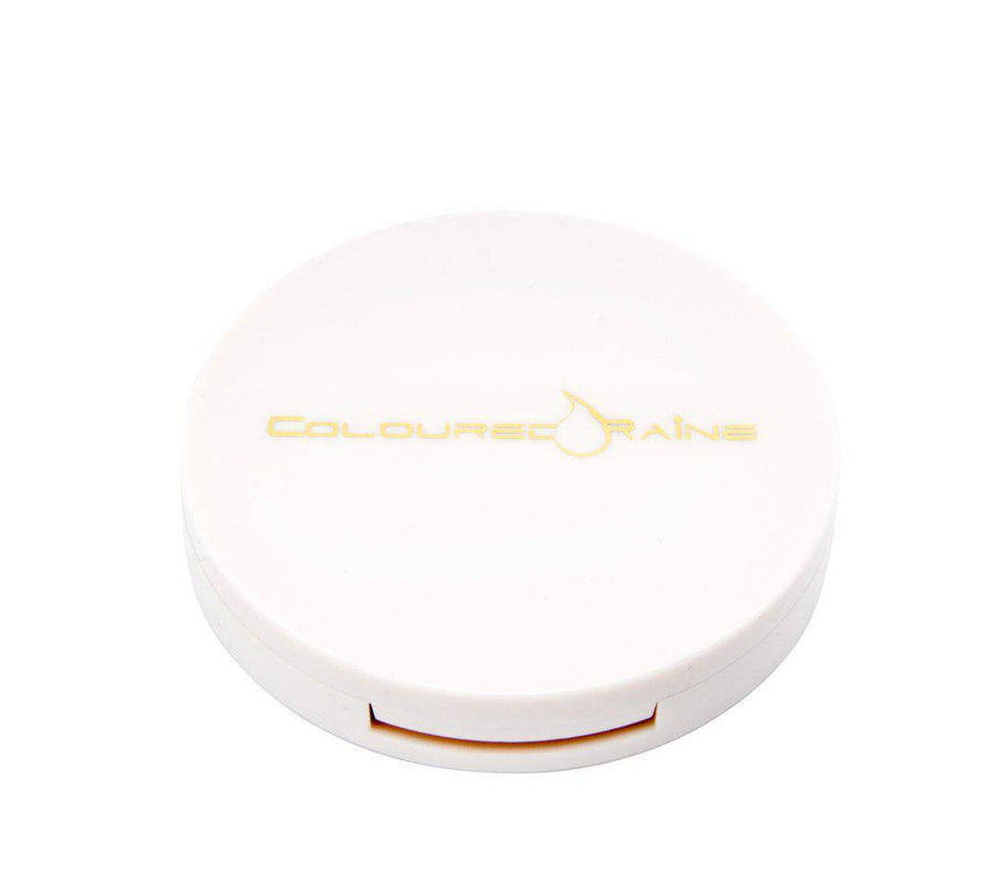 Just Peachy - Peach highlighter with gold undertones in a closed container. White, round, with gold Coloured Raine logo.