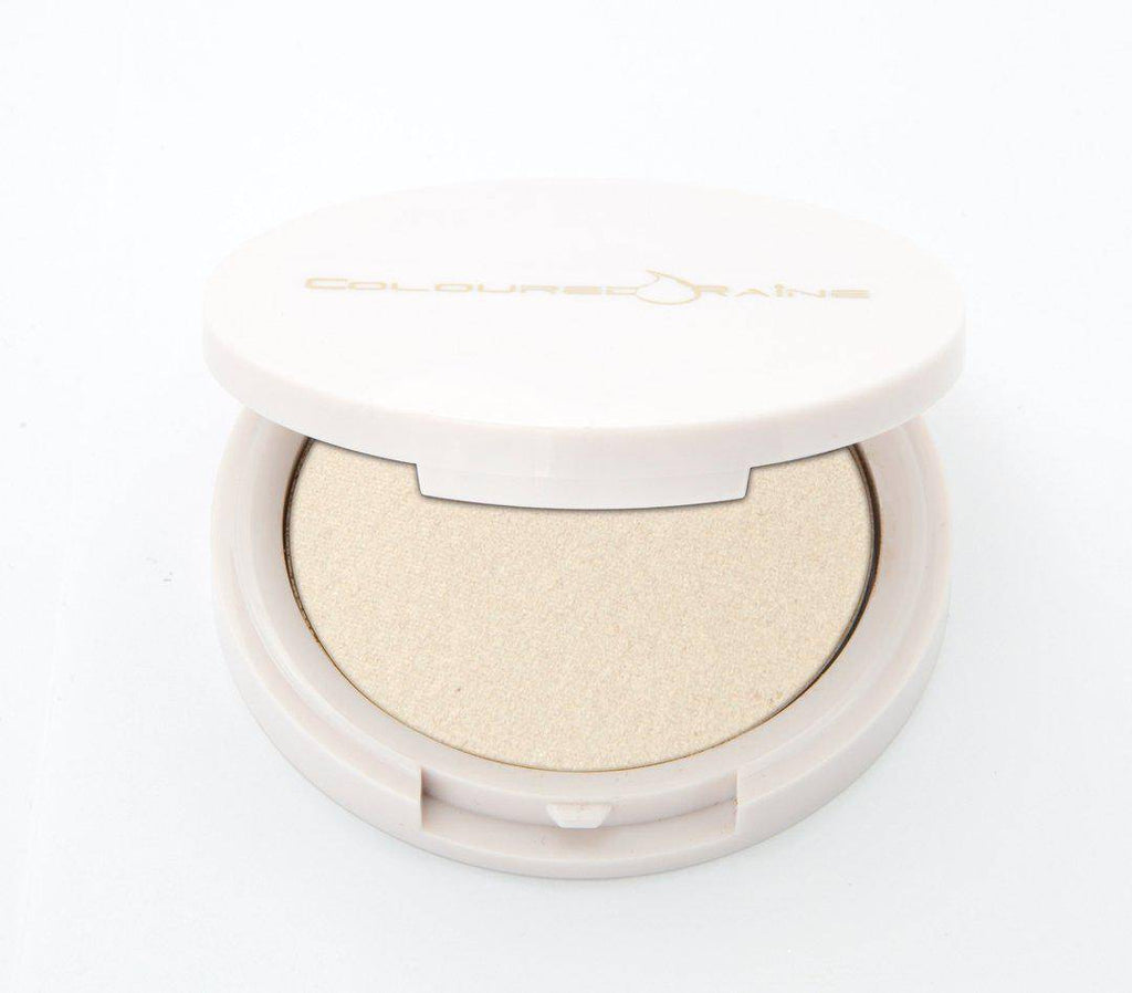Luxurious Bling translucent highlighter by Coloured Raine Cosmetics. Half-open, in a white, circular, mirrored container.