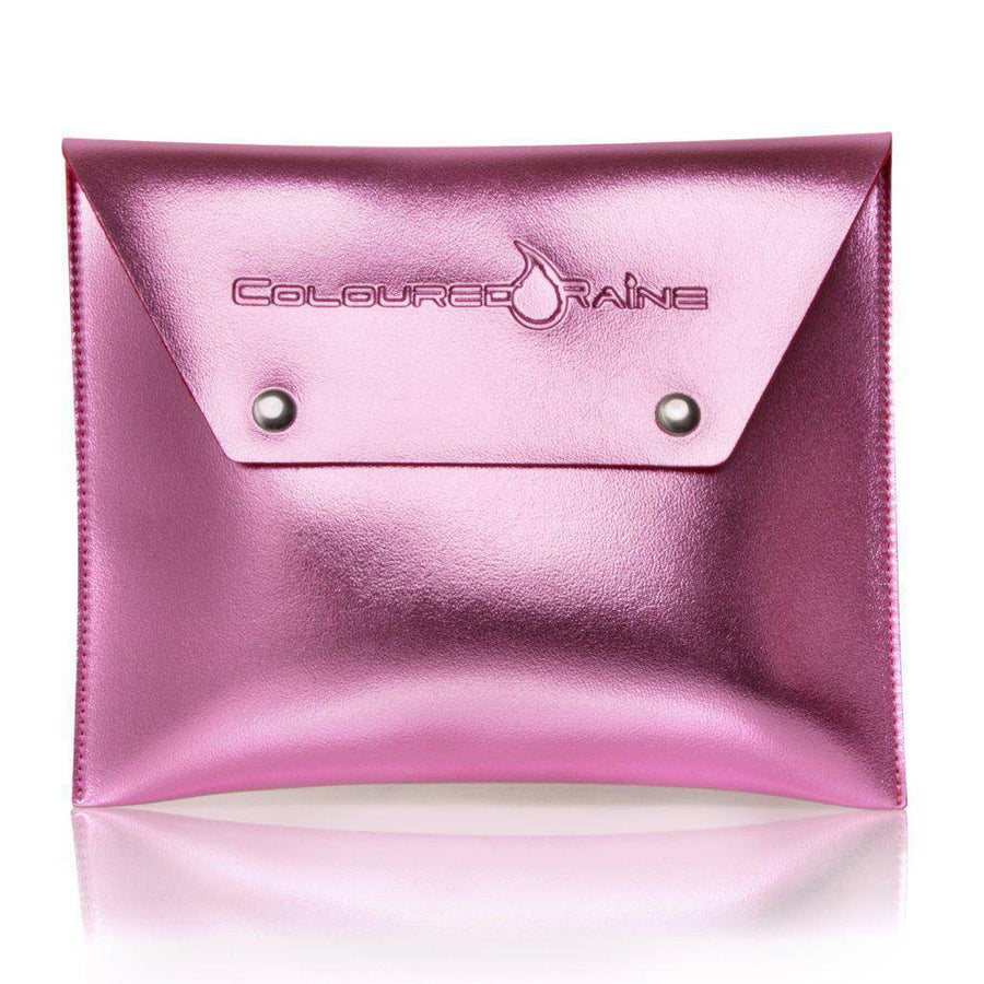 Metallic pink makeup clutch bag closed. Coloured Raine logo stamped on the front.