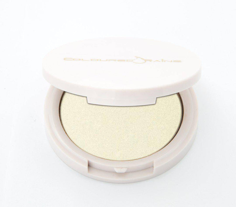 No Flash Needed - translucent highlighter by Coloured Raine Cosmetics. Half-open, in a white, circular, mirrored container.