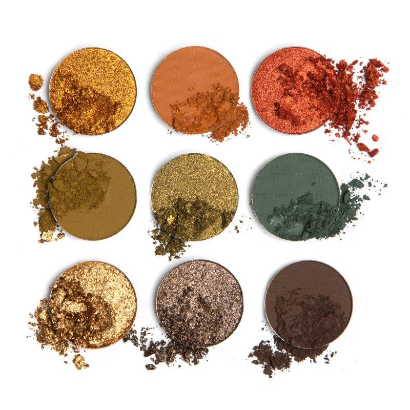 9 pan earth-toned eyeshadow palette single pans disrupted so the viewer can see the texture.