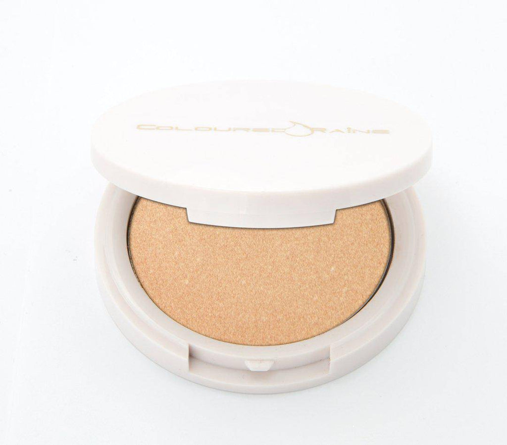 Selfie - Champagne highlighter by Coloured Raine Cosmetics. Half-open, in a white, circular, mirrored container.