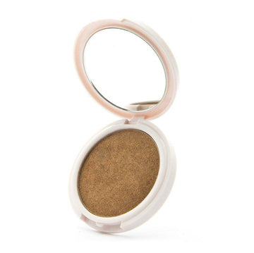 Your Treat - Golden bronze highlighter by Coloured Raine Cosmetics. Open, in a white, circular, mirrored container.