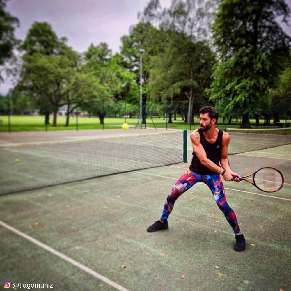Playing tennis in disarray mens leggings