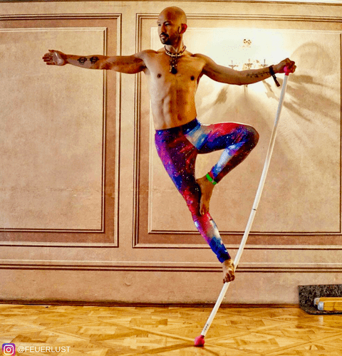 acrobat balancing in pole in mens galaxy leggings