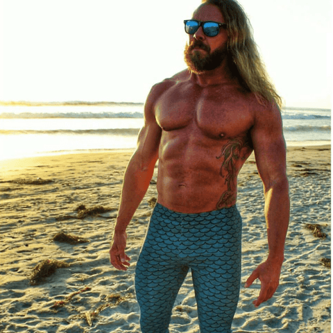 aquaman bodybuilder on beach wearing merman meggings