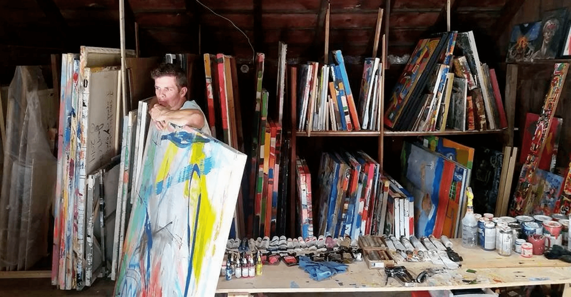 artist joseph ferm in studio with large canvasses