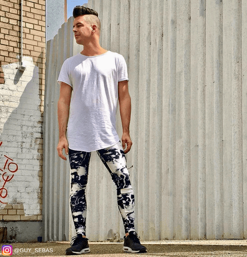 hipster posing in alley wearing black and white male leggings