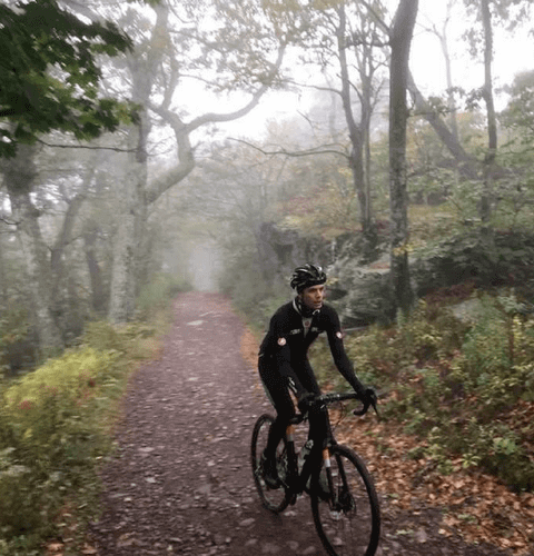 joseph ferm in mens leggings riding bike in woods