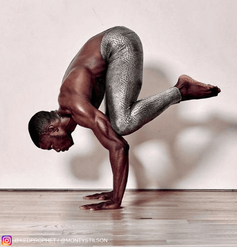 man doing yoga in silver snakeskin leggings