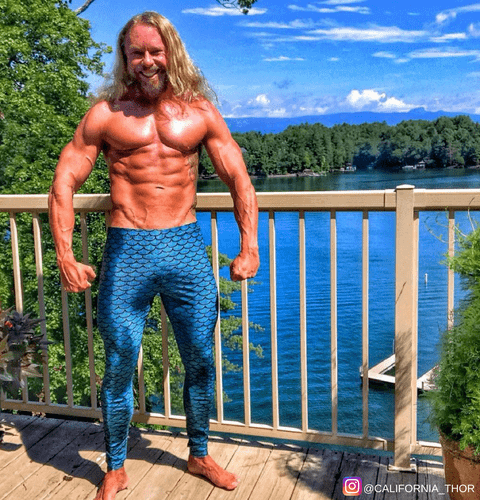 musly gym man wearing merman mens leggings at harbour