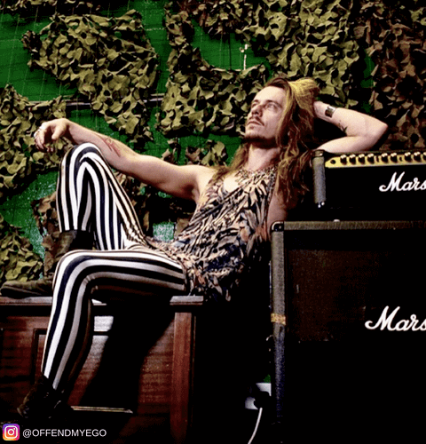 rock star band singer wearing black and white striped mens leggings