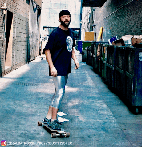skater wearing shiny silver kapow meggings in alley