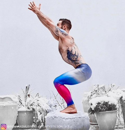 tattoo man doing yoga in blue pink mens tights