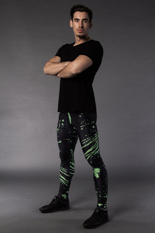 Man posing in Kapow Meggings black and electric green splattered men's leggings
