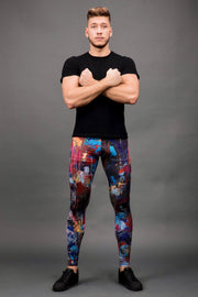 man posing wearing dark multi color leggings