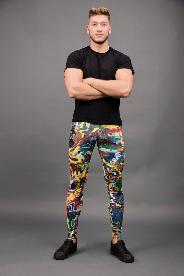 man posing wearing bright multi color leggings front