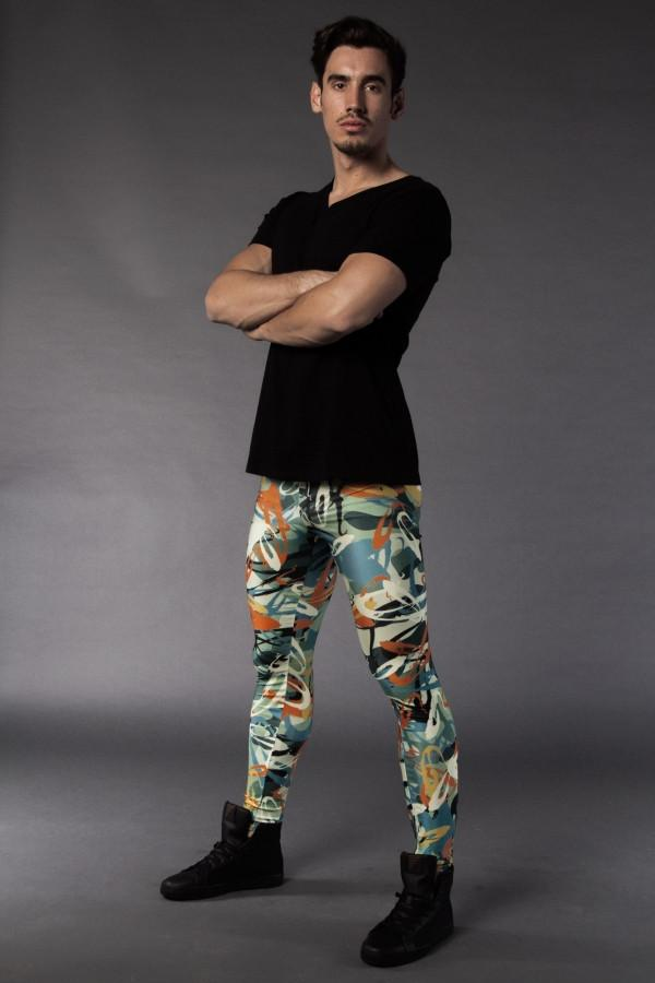 Man posing in Kapow Meggings graffiti themed men's leggings