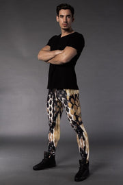 Man posing in Kapow Meggings black, white and orange beehive themed men's leggings